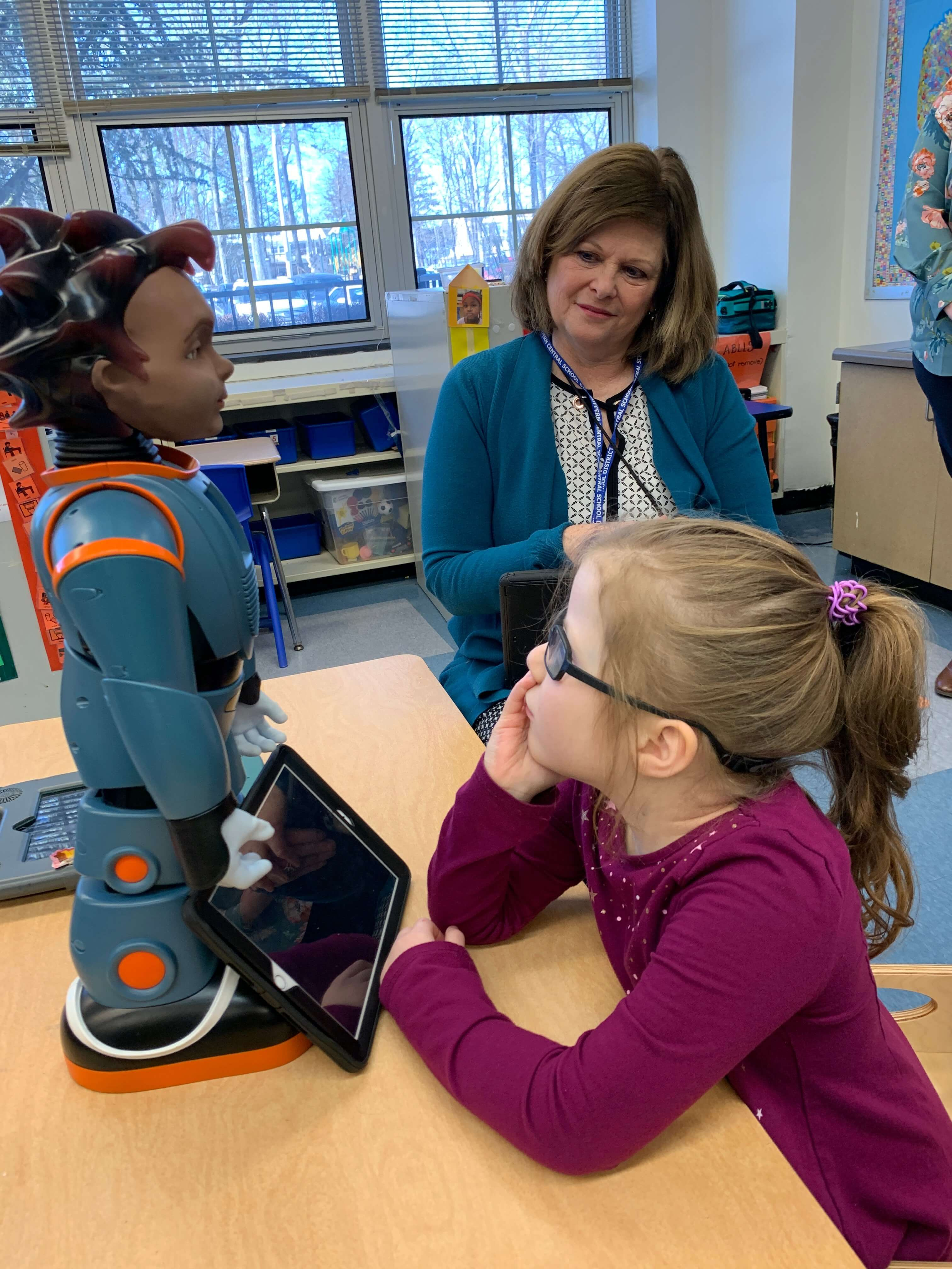 Autistic student engaging with RoboKind's social-emotional robots